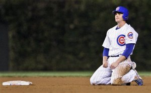 Chicago Cubs' Ryan Theriot is dejected after being forced out at second after teammate Derrek Lee hit into a double play against the Arizona Diamondbacks in the seventh inning in Game 3 of a National League Division Series playoff baseball game Saturday, Oct. 6, 2007, at Wrigley Field in Chicago. (AP Photo/M. Spencer Green)