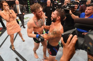 LAS VEGAS, NV - JULY 11: (L-R) Conor McGregor and Chad Mendes congratulate each other after their UFC interim featherweight title fight during the UFC 189 event inside MGM Grand Garden Arena on July 11, 2015 in Las Vegas, Nevada. (Photo by Josh Hedges/Zuffa LLC/Zuffa LLC via Getty Images)